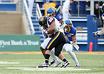 BROOKINGS, SD - NOVEMBER 16: Trevor Allen #25 of the Northern Iowa Panthers is brought down by Seven Wilson #7 of the South Dakota State Jackrabbits during their game Saturday afternoon at Dana J. Dykhouse Stadium in Brookings, SD. (Photo by Dave Eggen/Inertia)