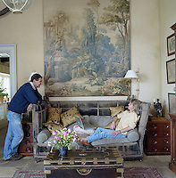 Charles Edwards and his partner Julia Boston relax in the large living room