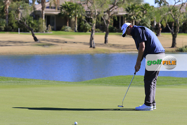Derek Fathauer (USA) putts on the 18th green during Saturday's Round 3 of the 2017 CareerBuilder Challenge held at PGA West, La Quinta, Palm Springs, California, USA.<br /> 21st January 2017.<br /> Picture: Eoin Clarke | Golffile<br /> <br /> <br /> All photos usage must carry mandatory copyright credit (&copy; Golffile | Eoin Clarke)