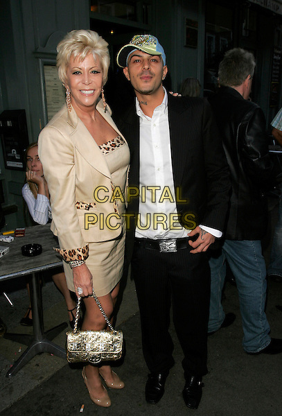 LISA VOICE & ABS BREEN.Attending the Hollywood Heat Book Launch Party, Beauchamp Bar, Beauchamp Place, London, England..August 12th 2008.full length gold jacket cap hat black suit bag leopard print nail varnish polish nails .CAP/AH.©Adam Houghton/Capital Pictures.
