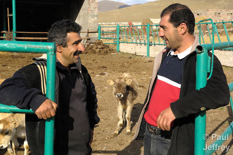 Student Rudik Mnatsakanyan talks with farm manager Armenl Karapetyan at an agricultural training center in Norabak, Armenia, sponsored by the United Methodist Committee on Relief.