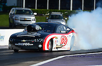 Apr. 27, 2012; Baytown, TX, USA: NHRA pro mod driver Rickie Smith during qualifying for the Spring Nationals at Royal Purple Raceway. Mandatory Credit: Mark J. Rebilas-