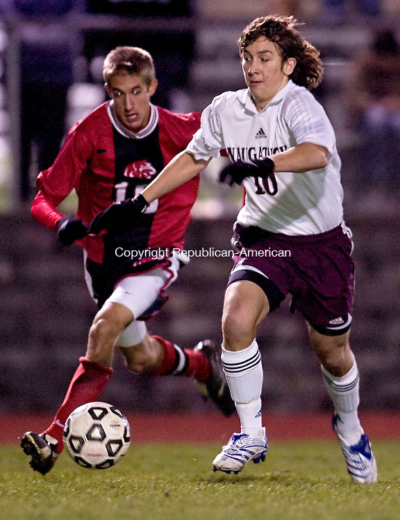 NAUGATUCK, CT--07 November 07--110707TJ14 - Masuk's Patrick Martin (10), left, chases Naugatuck's Tony Sendra (10) during Naugatuck High School's 1-0 victory over Masuk High School in the first round of the CIAC class LL boys tournament in Naugatuck, Conn., on Wednesday, November 7, 2007. T.J. Kirkpatrick/Republican-American