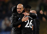 Josep Guardiola manager of Manchester City hugs Riyad Marhez of Manchester City and moves in to give him a kiss before sending him on as a substitute  during the Premier League match at Turf Moor, Burnley. Picture date: 3rd December 2019. Picture credit should read: Simon Bellis/Sportimage