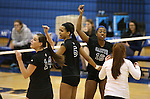 The Marymount Saints look for a call in a college volleyball game, in Arlington, Vir., on Saturday, Nov. 1, 2014.<br /> Photo by Cathleen Allison