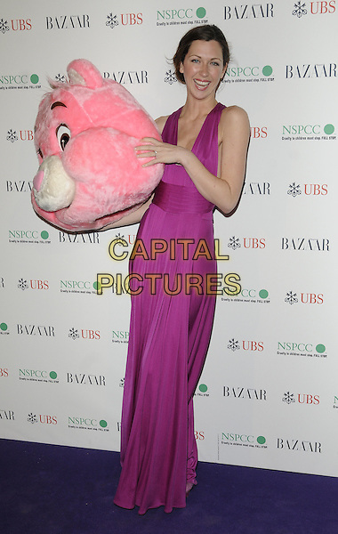 MARGO STILLEY.The Surrealist Ball in aid of NSPCC at The Banqueting House, London, England..March 17th, 2011.full length pink fuschia maxi dress sleeveless smiling holding carrying  head mask care bear funny.CAP/CAN.©Can Nguyen/Capital Pictures.