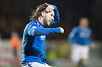 Dundee United v St Johnstone...12.03.14    SPFL<br /> Stevie May celebrates his goal marking his haircut<br /> Picture by Graeme Hart.<br /> Copyright Perthshire Picture Agency<br /> Tel: 01738 623350  Mobile: 07990 594431