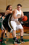 SPEARFISH, SD - JANUARY 4, 2013:  Logan Cowan #44 of Black Hills State drives into pressure  from Kelly Hernandez #50 of Adams State during their Rocky Mountain Athletic Conference Basketball game Friday at the Young Center in Spearfish, S.D.  (Photo by Richard Carlson/dakotapress.org)
