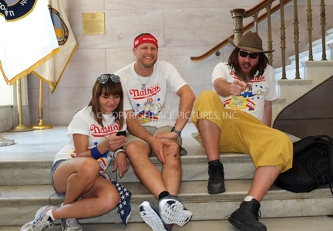 WWW.ACEPIXS.COM<br /> <br /> July 3 2015, New York City<br /> <br /> Contestants at the weigh-in for the annual Nathan's Hotdog Eating Contest at Brooklyn Brorough Hall on July 3 2015 in New York City<br /> <br /> By Line: Curtis Means/ACE Pictures<br /> <br /> <br /> ACE Pictures, Inc.<br /> tel: 646 769 0430<br /> Email: info@acepixs.com<br /> www.acepixs.com