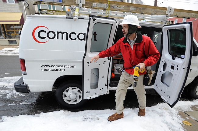 Comcast Field Servcie Technician Randy Groves makes a service call Wednesday, Jan 19, 2011 in Reading, Pa. (Bradley C Bower/Bloomberg News)