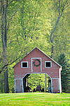 Old outbuilding with tractor in Spring.