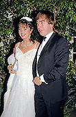 English composer Andrew Lloyd Webber, right, and his wife, Sarah Brightman, left, arrive at the White House in Washington, DC for the State Dinner hosted by United States President Ronald Reagan and first lady Nancy Reagan honoring Prime Minister Margaret Thatcher of Great Britain at the White House in Washington, DC on November 16, 1988.<br /> Credit: Ron Sachs / CNP