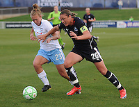 Washington Freedom forward Abby Wambach (20) pushes her way to the goal, while Chicago Red Stars defender Nicole Krzysik (23) defends.  Washington Freedom tied Chicago Red Stars  1-1 at The Maryland SoccerPlex, Saturday April 11, 2009.