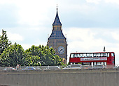 "London, GBR - August 7, 2005 -- A double decker bus crossing the Waterloo Bridge in London, Great Britain, on August 7, 2005.  The Clock Tower of the Palace of Westminster, popularly known as ""Big Ben""  looms large in the background.  ""Big Ben"" and double decker buses are two recognizable symbols when one thinks of London.  This view was made from a ferry on the Thames River. .Credit: Ron Sachs / CNP"