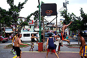 Filipino youth play basketball at the Remedios circle in Malate, Manila in Philippines. Photo: Sanjit Das