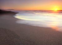 Sunset along a sandy beach in Point Reyes, California.
