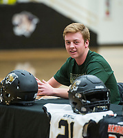 NWA Democrat-Gazette/BEN GOFF @NWABENGOFF<br /> Easton Hughes, Bentonville football player, makes remarks as coach Jody Grant looks on Wednesday, Feb. 6, 2019, during a signing ceremony at Bentonville's Tiger Arena. Hughes signed to play at Arkansas Tech.