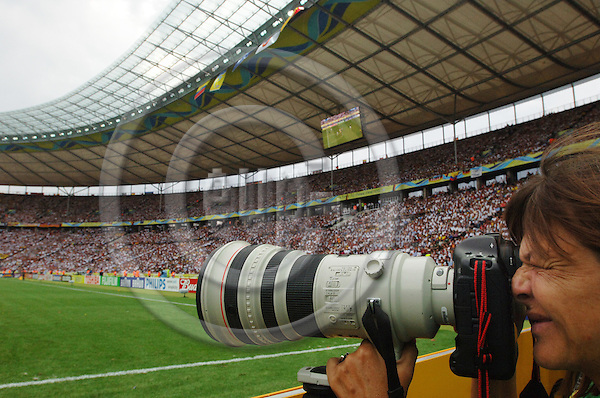 """BERLIN - GERMANY 20. JUNE 2006 - Olympiastadion --A photographer shooting with a long lens -- PHOTO: GORM K. GAARE / EUP & IMAGES..This image is delivered according to terms set out in """"Terms - Prices & Terms"""". (Please see www.eup-images.com for more details)"""