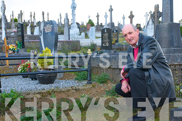 Fr Pat O'Donnell at the Duffey's grave  in Rathmore. The discovery of the unmarked grave was made during the mapping of the local graveyard.
