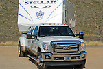 2011 Ford Super Duty towing Fifth Wheeler.