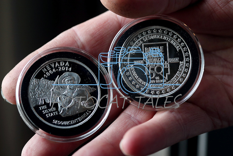 Coiner Ken Hopple holds a sample of the state sesquicentennial medallions with the second design at the Nevada State Museum, in Carson City, Nev., on Wednesday, Feb. 26, 2014.<br /> Photo by Cathleen Allison/Nevada Photo Source