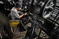 A bicycle worker works on a tube bender machine in a small scale bicycle factory in Bogota, Colombia, 10 April 2013. Due to the strong, vibrant cycling culture in Colombia, with cycling being one of the two most popular sports in the country, dozens of bike workshops and artisanal, often family-run bicycle factories were always spread out through the Colombian cities. However, growing import of cheap bicycles and components from China during the last decade has led to a significant decline in domestic bicycle production. Traditional no-name bike manufacturers are forced to close down their factories, struggling to survive in the competitive bicycle market.
