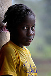 A girl, wet from a rain storm, in Mizak, a small village in the south of Haiti.