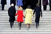 Washington, DC - January 20, 2009 -- (L-R) Vice President Joe Biden, Jill Biden, Michelle Obama and President Barack Obama walk up the steps of the East Front of the US Capitol Building after seeing off a Marine helicopter with former President George W. Bush on board after Barack Obama was sworn in as the 44th President of the United States in Washington, DC, USA 20 January 2009.  Obama defeated Republican candidate John McCain on Election Day 04 November 2008 to become the next U.S. President..Credit: Tannen Maury - Pool via CNP