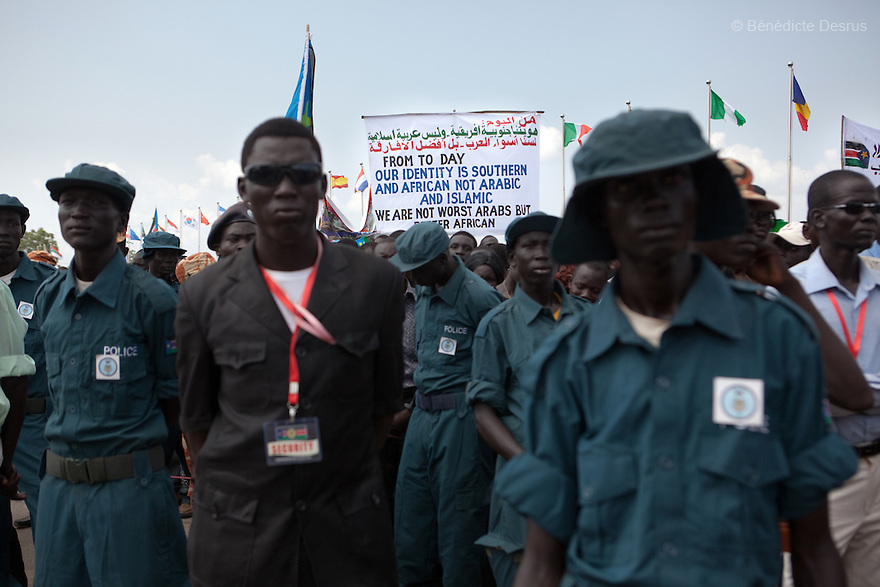 "Saturday 9 july 2011 - Juba, Republic of South Sudan - South Sudanese hold a banner with the message: ""From today our identity is Southern and African not arabic and islamic. We are not worst arabs but better African"" during South Sudan's independence day celebrations in Juba. Tens of thousands of citizens of the new South Sudan celebrate national independence but whether statehood will resolve issues of identity after a decades-long war remains to be seen. Photo credit: Benedicte Desrus"