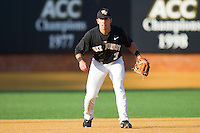 Third baseman Carlos Lopez #3 of the Wake Forest Demon Deacons on defense against the Western Carolina Catamounts at Gene Hooks Field on February 22, 2011 in Winston-Salem, North Carolina.  Photo by Brian Westerholt / Four Seam Images