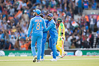 Virat Kolli (India) congratulates Bhuvneshwar Kumar -obscured - (India) on the wicket of Marcus Stones (Australia) during India vs Australia, ICC World Cup Cricket at The Oval on 9th June 2019