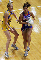 Mystics wing attack Keshia Grant takes a pass under pressure from Camilla Lees during the ANZ Netball Championship match between the Central Pulse and Northern Mystics, TSB Bank Arena, Wellington, New Zealand on Monday, 4 May 2009. Photo: Dave Lintott / lintottphoto.co.nz