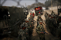 Royal Nepal Army troops prepare to load onto trucks after a military display for Army Day in Kathmandu, Nepal on 19 February, 2006.<br />