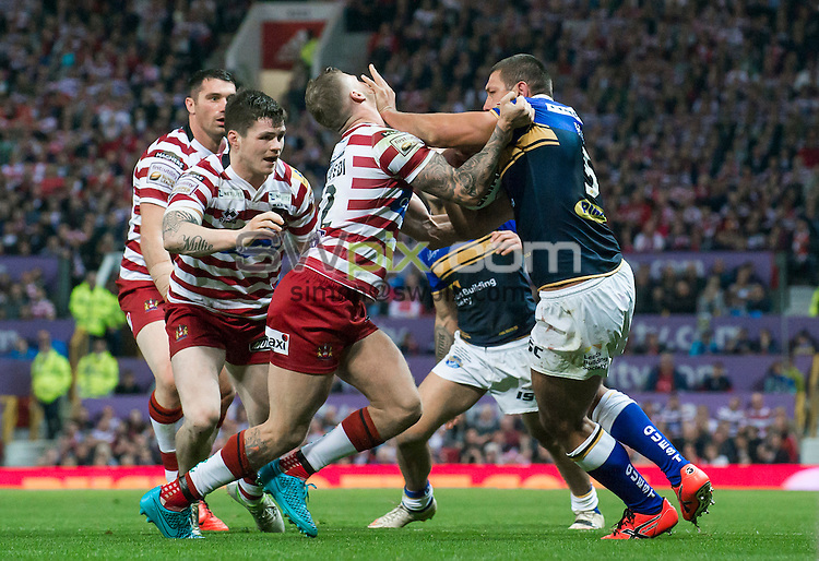 Picture by Allan McKenzie/SWpix.com - 10/10/2015 - Rugby League - First Utility Super League Grand Final - Leeds Rhinos v Wigan Warriors - Old Trafford, Manchester, England - Leeds's Ryan Hall fends off Wigan's Dominic Manfredi.
