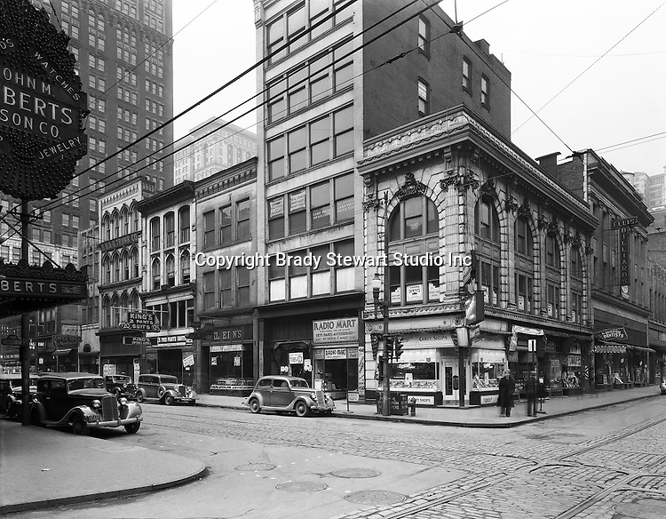 Diamond and Wood Streets - Pittsburgh Pennsylvania 1935. Founded in 1832 in a log cabin, John M. Roberts &amp; Son Co. moved to Wood and Diamond streets in 1925. Mr. Roberts was the fourth generation of his family to work in the business. Owners often said it was the oldest emporium in Pittsburgh, the first to use lighting in its display windows, and proudly boasted of customers such as George Westinghouse, railroad financier and philanthropist Diamond Jim Brady, singer Lillian Russell and pianist Liberace.<br />