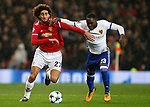 Marouane Fellaini of Manchester United (L) is tackled by Eder Alvarez Balanta of Basel during the Champions League Group A match at the Old Trafford Stadium, Manchester. Picture date: September 12th 2017. Picture credit should read: Andrew Yates/Sportimage