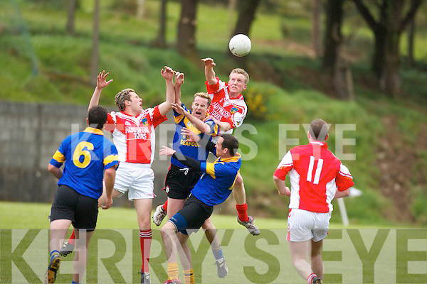 Got it. Kenmare midfielder Sean Hussey holds on to the ball despite being surrounded by Shane Hennessey and Emmet Kennedy in their County Championship clash at Annascaul on Sunday..