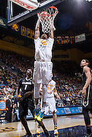California's Richard Solomon jumps for the basket during a game against Colorado at Haas Pavilion in Berkeley, California on March 8th, 2014. California defeated Colorado 66 - 65