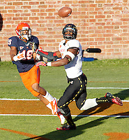 Virginia Cavaliers wide receiver E.J. Scott (19) catches a 3rd quarter touchdown in front of Maryland Terrapins linebacker Kenneth Tate (6) Saturday at Scott Stadium in Charlottesville, VA. Maryland defeated Virginia 27-20.