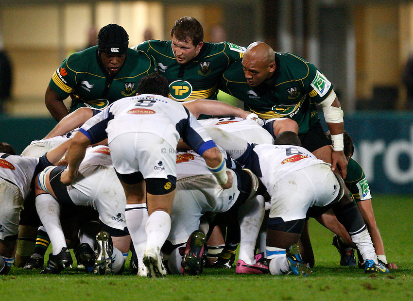Photo: Richard Lane/Richard Lane Photography. Northampton Saints v Castres Olympique. Heineken Cup. 08/10/2010. Saints' front row (lt to rt) Brian Mujati, Dylan Hartley and Soane Tonga'uiha.