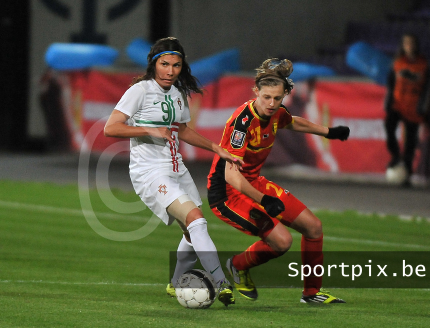 20131031 - ANTWERPEN , BELGIUM : Belgian Yana Daniels (21) pictured with Portugese Ana Borges (9) during the female soccer match between Belgium and Portugal , on the fourth matchday in group 5 of the UEFA qualifying round to the FIFA Women World Cup in Canada 2015 at Het Kiel stadium , Antwerp . Thursday 31st October 2013. PHOTO DAVID CATRY