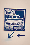 Home-made sign with ferry boat, direction arrows--where are you going kapa bakij, Anafi, Greece