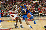 Guard Andrew Harrison of the Kentucky Wildcats drives to the basket during the game against  the Louisville Cardinals at KFC Yum! Center on Saturday, December 27, 2014 in Louisville `, Ky. Kentucky leads Louisville 22-18 at halftime. Photo by Michael Reaves | Staff