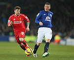James McCarthy of Everton gets the ball away from Alberto Moreno of Liverpool  - Barclays Premier League - Everton vs Liverpool - Goodison Park Stadium  - Liverpool - England - 7th February 2015 - Picture Simon Bellis/Sportimage