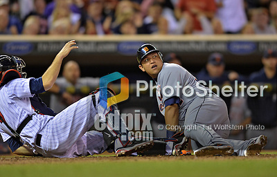 28 September 2012: Detroit Tigers third baseman Miguel Cabrera looks up at the umpire after being tagged out at the plate by catcher Joe Mauer during a game against the Minnesota Twins at Target Field in Minneapolis, MN. The Twins defeated the Tigers 4-2 in the first game of their 3-game series. Mandatory Credit: Ed Wolfstein Photo