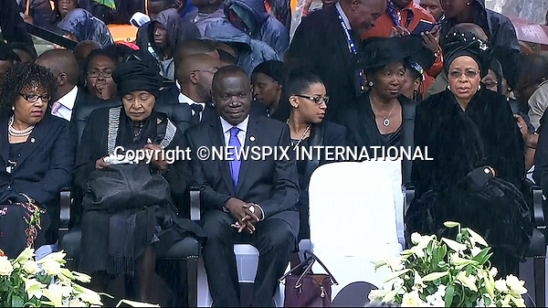 WINNIE MANDELA AND NELSON'S WIDOW GRACA MACHEL(right)<br /> NELSON MANDELA MEMORIAL<br /> The nation mourns Nelson Rolihlahla Mandela Memorial Service, FNB Stadium, Johannesburg, South Africa<br /> Mandatory Credit Photo: &copy;NEWSPIX INTERNATIONAL<br /> <br /> **ALL FEES PAYABLE TO: &quot;NEWSPIX INTERNATIONAL&quot;**<br /> <br /> IMMEDIATE CONFIRMATION OF USAGE REQUIRED:<br /> Newspix International, 31 Chinnery Hill, Bishop's Stortford, ENGLAND CM23 3PS<br /> Tel:+441279 324672  ; Fax: +441279656877<br /> Mobile:  07775681153<br /> e-mail: info@newspixinternational.co.uk