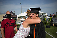 Shelby King hugs graduate Tyler Stacy, Friday, July 17, 2020 during a graduation ceremony at Bentonville High School in Bentonville. Check out nwaonline.com/200718Daily/ for today's photo gallery. <br /> (NWA Democrat-Gazette/Charlie Kaijo)