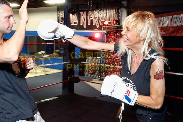 NUTLEY, NJ - MAY 27 :  Tam Mom training for her first World Extreme Entertainment boxing match to be held on June 21, 2014 at Harrahs Philadelphia in her home town  and poses in the ring at IWF Centre in Nutley, New Jersey on May 27, 2014  ***EXCLUSIVE HIGHER RATES APPLY***   <br /> CAP/MPI/STA<br /> &copy;Star Shooter/MediaPunch/Capital Pictures