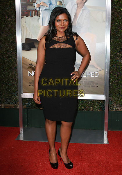 "MINDY KALING.""No Strings Attached"" Los Angeles Premiere held At The Regency Village Theatre, Westwood, CA, USA..January 11th, 2010.full length black dress hand on hip lace .CAP/ADM/KB.©Kevan Brooks/AdMedia/Capital Pictures."