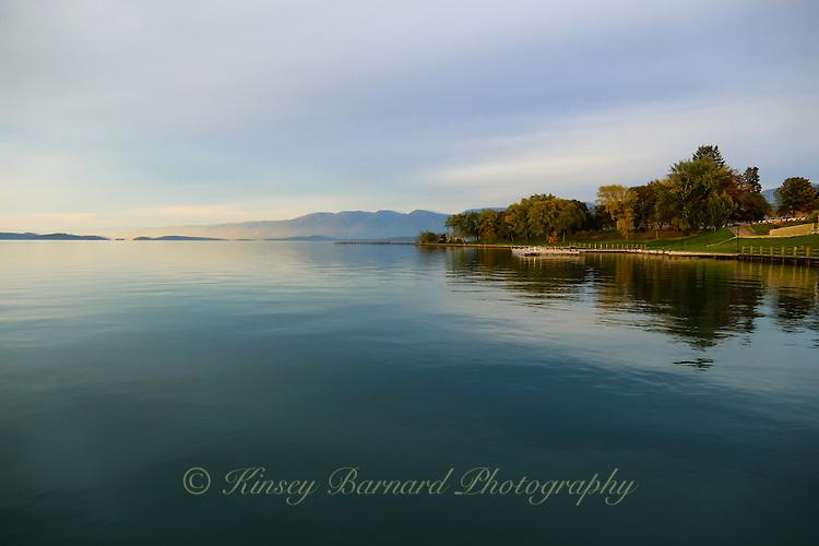 As pretty as a painting image of a sunset on Flathead Lake near Polson, Montana